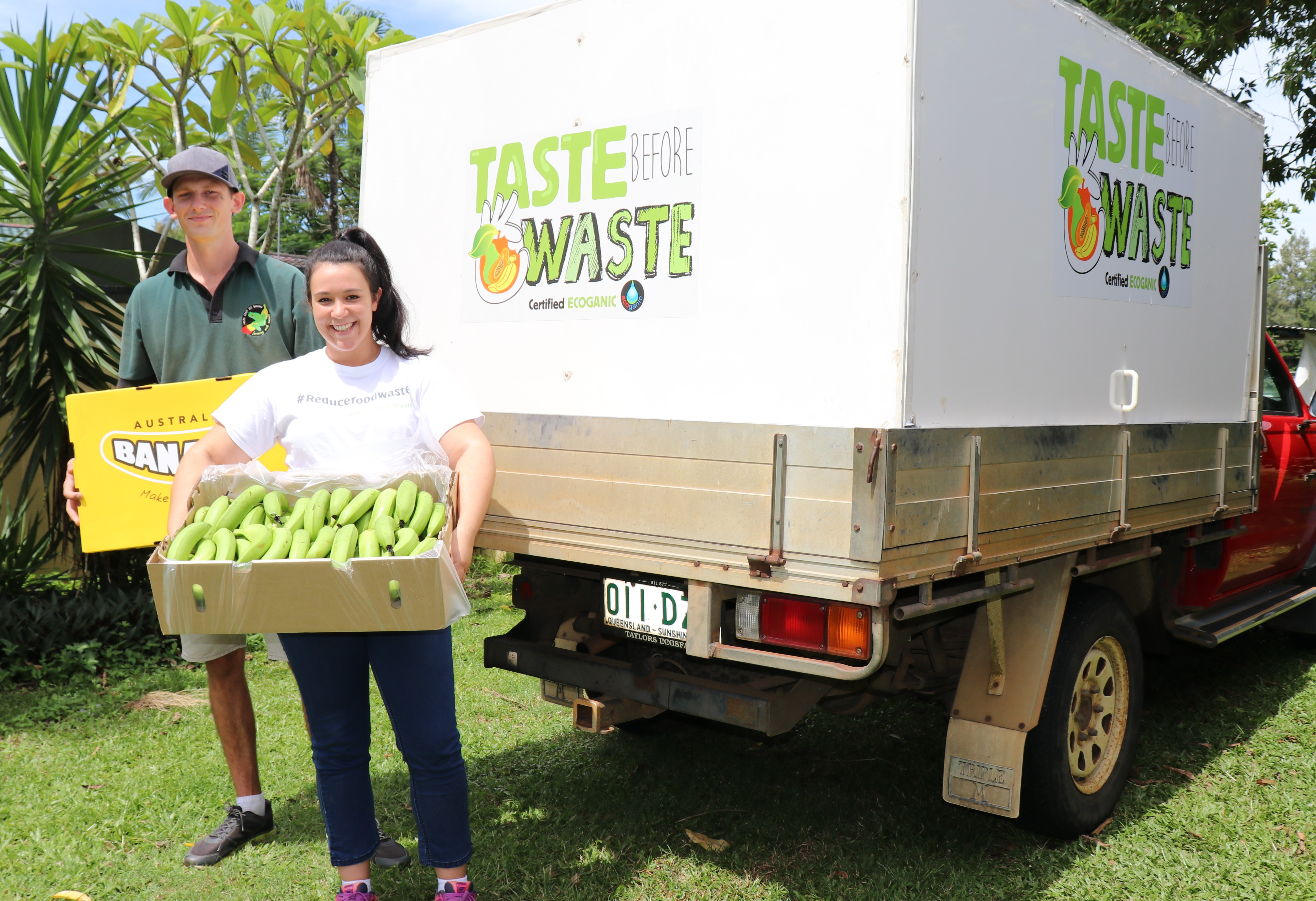 Alana Sciacca and her partner Jake Siltanen with some of the seconds bananas they deliver to households across North Queensland.