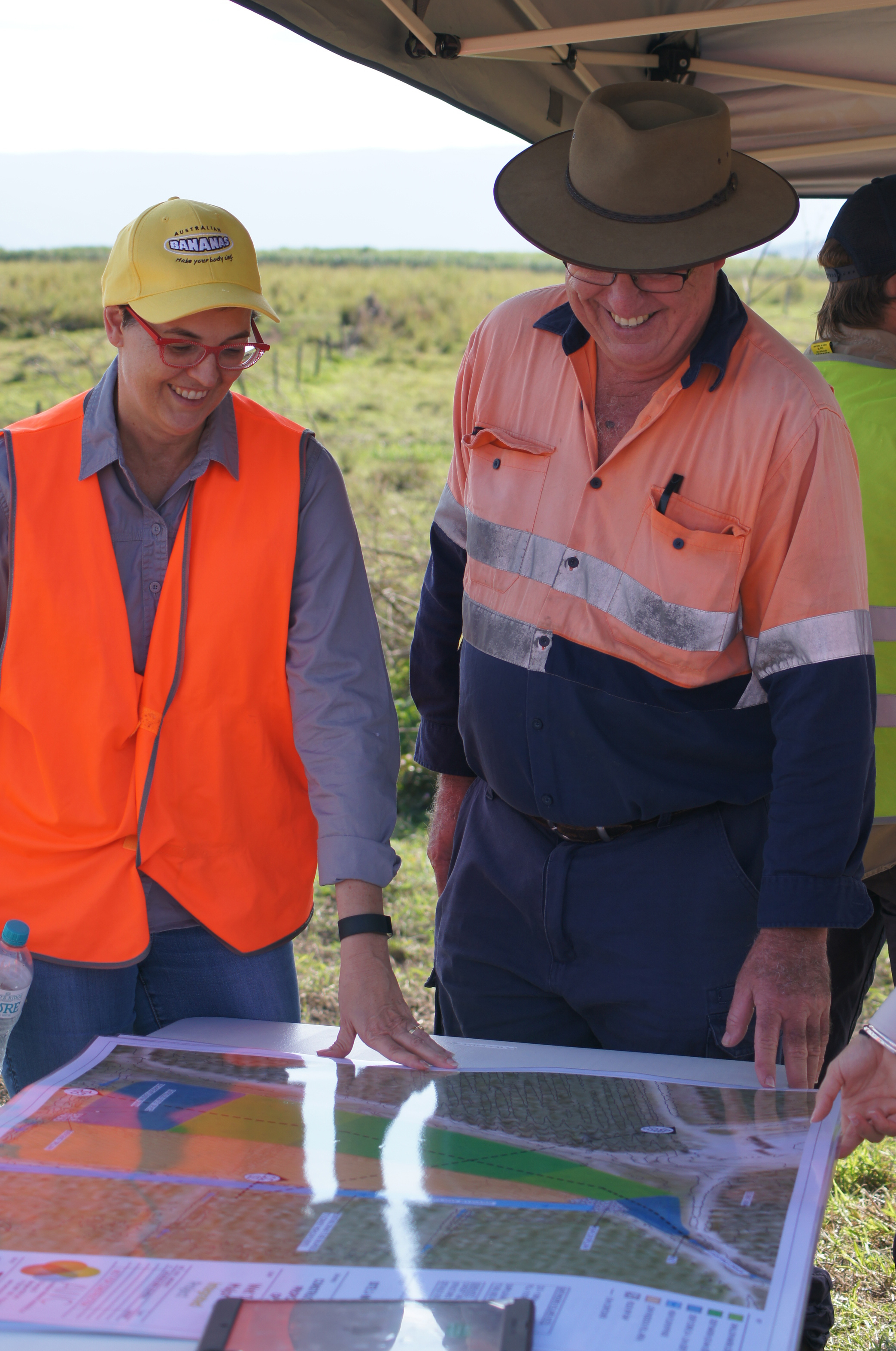 Michelle McKinlay and Robert Mayers look at the draft designs for a treatment system on a banana farm.