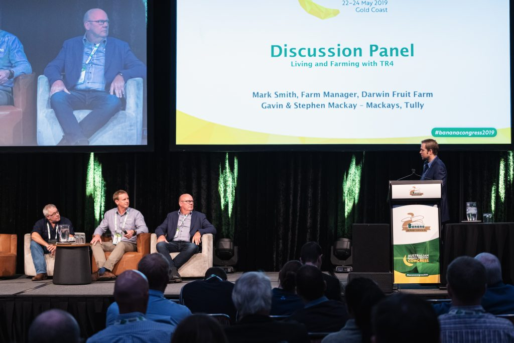L-R: Mark Smith (Darwin Fruit Farm), Gavin and Stephen MacKay (MacKays Farming) are quizzed by Congress Chair Paul Inderbitzin during the Living with TR4 panel.