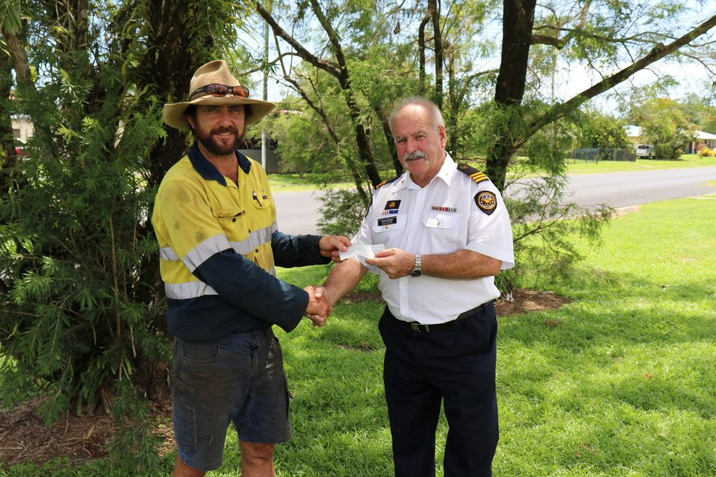 Neville Duncan, Innisfail Floatilla Commander, receives the funds raised at the 2018 event on behalf of the Australian Volunteer Coastguard – Innisfail Division. He's pictured with BGA Chair Dean Sinton.
