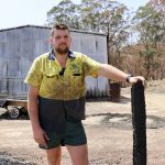 Clinton Welsh with the trailer and shed he lost during the recent bushfires.