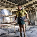 Clinton Welsh inside his packing shed which was gutted by fire.